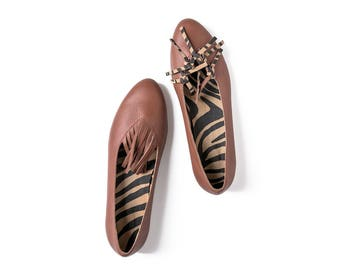Brown ballet flats with fringes