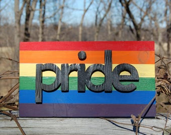 PRIDE sign made from cedar treehouse scraps