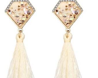 Crystal and tassel earrings