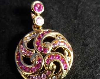 Beautiful sterling silver pendant with synthetic stones