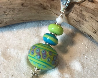 """Necklace green pendand glass lampwork stacked beads """"Alien"""" with crystals."""