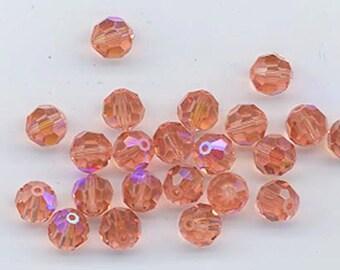 Check this out - twelve vintage Swarovski peach AB crystals - Art. 5000 -6 mm - so rare