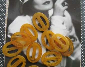 Vintage Bakelite Buckles...tiny...set of 18...perfect for jewelry....new old stock...1930