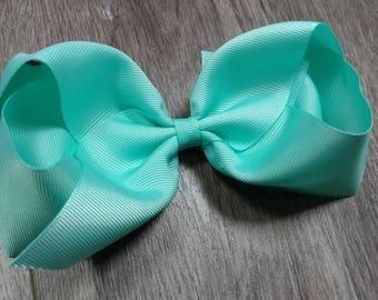 Southern style aqua hair bow. 6 inch hair bow period 6 in aqua hair bow. Extra large hair bow. Big aqua hair bow. Big southern style Aqua bo