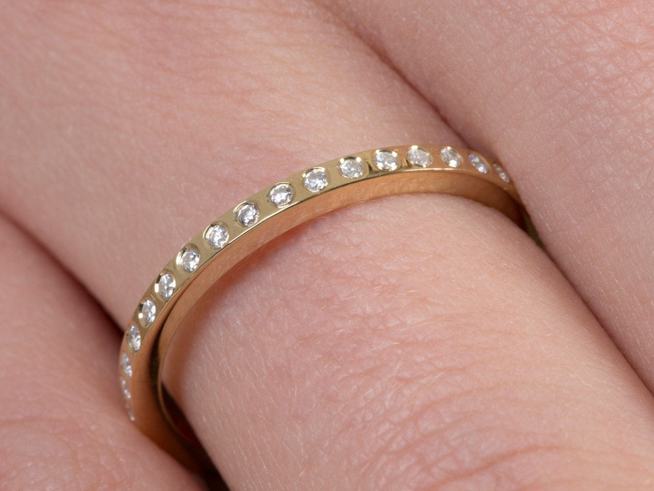Diamond eternity band Embedded diamonds All around diamond