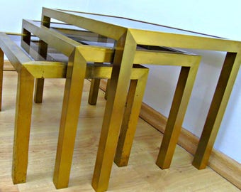 Set of brass nesting tables with smoked glass vintage display tables Maison Jansen style , authentic 1960s hollywood regency coffeetables