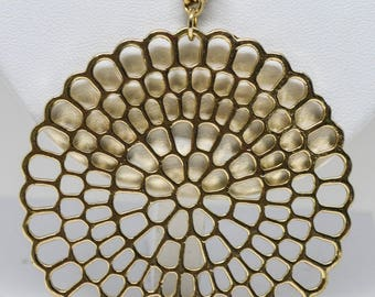 Stunning gold tone necklace with large pendant