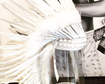 A Feathered headdress with shell detail