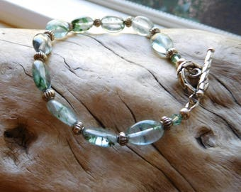Moss Agate Bracelet.  Swirls of green in a transluscent  mineral.  Kelp.  Seaweed.  Ocean vibe.  Sale.  Was 24.00  Now 12.00