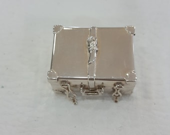 Silver miniature old suitcase