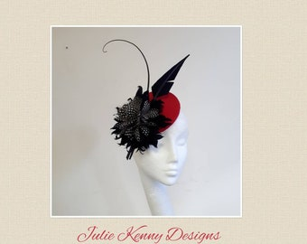Red mini coolie with feather flower fascinator