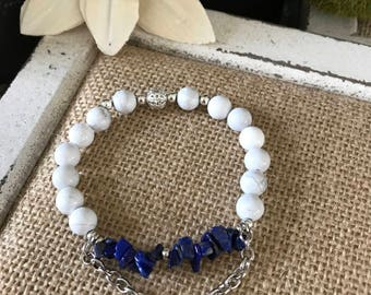 Blue Lapis chip beads with white turquoise and silver chain and accents.  Stretchy elastic, fits most.