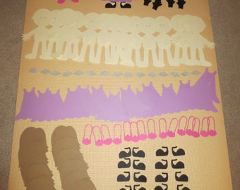 Set of 14 paper doll cutouts with accessories