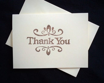 7 thank you cards and envelopes . Hand stamped .