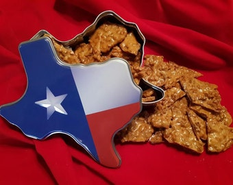 TEXAS PECAN BRITTLE packaged in a collectible Texas tin, made fresh to order with local new crop pecans, crunchy and buttery gourmet brittle