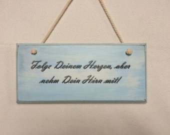 light blue mural with slogan on wood, wall decoration in the Shabby-Chic image on wood