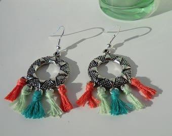 Green and coral tassel earrings.