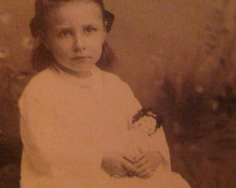 Antique Studio Portrait Cabinet Card of Young Child with China head Doll