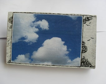 """woodart """"fly with me"""", object, with fotoprint on paper, clouds and blue sky, original drawing with ink liner"""