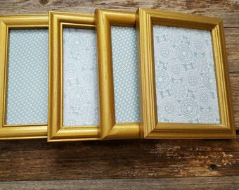 Set of four 5x7 gold metallic frames