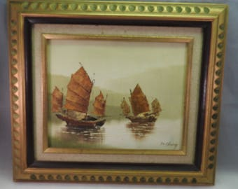 20th Century Chinese school, oil on canvas of boats, Junk on calm water' framed,signed F.C.Chuincg