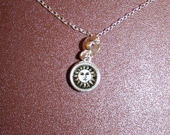 Silver necklace with pale moon and coloured sun pendant. Chain is 8 inches (21 cm) in length.