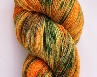 A beautiful soft Hand dyed yarn on a 4 ply, sock weight, merino, nylon base in shades of orange and green with hints of brown.