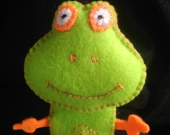 Orange and green felt frog finger puppet