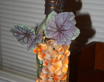Wine Bottle Night Light with peach stones, grape leaves and copper wire with charm.