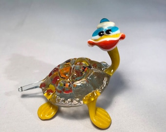 Smiling glass colorful turtle