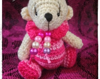 Miniature thread crochet artist bear.