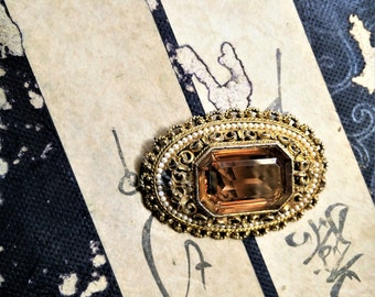 Vintage Pin. Vintage Brooch. Amber glass crystal and faux pearl pin/brooch.  Highly decorative filigree surrounds large crystal.