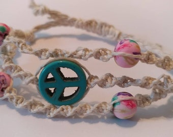 Hemp macrame bracelet or ankle with turquoise peace sign and pink floral clay beads.   Adjustable