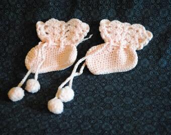 Vintage hand knit pink newborn baby booties