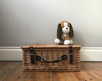 Vintage wicker basket with dark brown leather handle and straps perfect for storage
