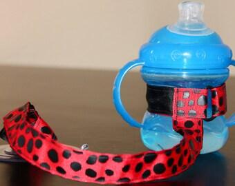 Laisse de gobelet, tasse à courroie, d'aspiration à sangle, nouveau cadeau de bébé, cadeau de Noël - rouge Dalmatien
