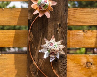 Copper and metal flowers on recycled wood for indoor or out.