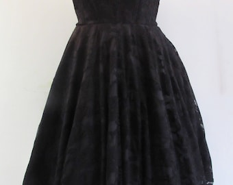 Short black lace dress with sweetheart neckline