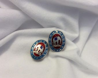 Blue & red enamel with silver Siam elephant design oval clip on earrings.