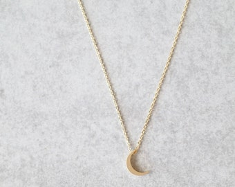 A sweet little crescent moon pendant on a delicate Rose gold Silver chain 18
