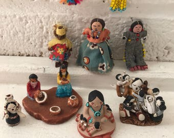 Collection of 9 miniature native Americans miniatures