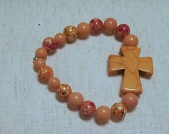 Orange stretch cord bracelet with Cross