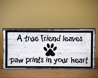 A True Friend Leaves Paw Prints In Your Heart