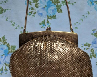 1940s Whiting and Davis gold mesh handbag with accessories