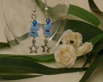 Earrings in blue felt with tiny star charms