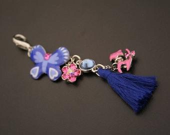 A beautiful charm pendant, metal, rhinestones and tassel. (ref:3629).