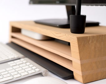 Ultimate display / monitor stand with Mac mini, Wacom (drawing tablet), Keyboard storage opportunities. The perfect desk cleaner.