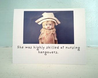 "Adventures of Claudia Porcelain Doll Drinking Notecard ""Nursing"" Funny Hangover Card"