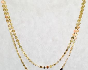 Glossy metal gold filled disc lend a glam layered look.  This necklace can be easily worn to any occassion to update your look.