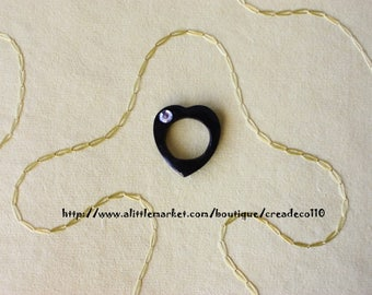 Black heart adorned with a handmade Fimo size 58 made rhinestone ring